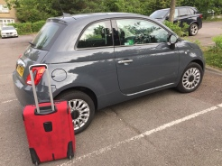 My suitcase is full of beer, and therefore about 1/4 the size of the adorable Fiat.