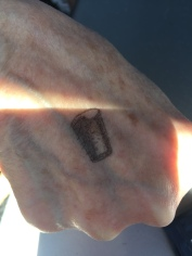 That's a pint glass hand stamp- on the back of my 76 year old Mother's hand.